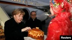Канцлер Германии Ангела Меркель на церемонии встречи в столице Беларуси. Минск, 11 февраля 2015 года.