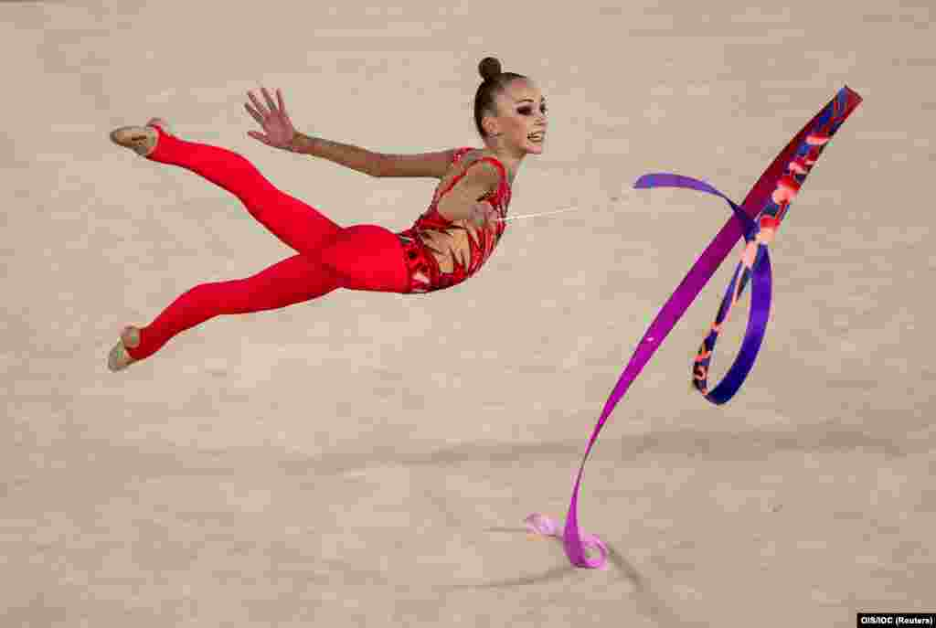 Khrystyna Pohranychna of Ukraine competes in the ribbon routine during the rhythmic gymnastics women's individual all-around during the Youth Olympic Games in Buenos Aires, Argentina, on October 16. (Reuters/Jed Leicester)