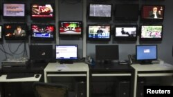 Afghanistan -- TV screens at Tolo TV, Kabul.