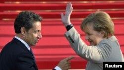 Керівники Франції і Німеччини Ніколя Саркозі та Анґела Меркель