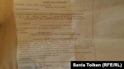 Повестка с требованием явиться в полицию, врученная Сание Тойкен 21 января.