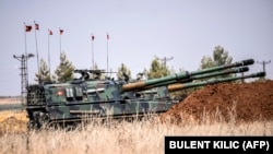 Turkish military tanks are seen during clashes between Turkish soldiers and Islamic State fighters 20 kilometer west of the Turkish-Syrian border town of Karkamis, in the southern region of Gaziantep, on September 3.