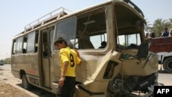 A bus that was hit by a roadside bomb attack in Baghdad's Sadr City district.