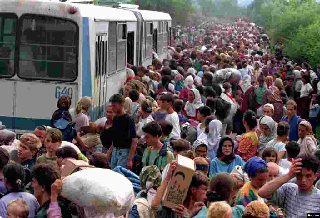 These people were the lucky ones. Around 10,000 refugees from Srebrenica board buses at a camp outside the UN base at Tuzla Airport on July 14, 1995. Just three days earlier, on July 11, Bosnian Serb forces started slaughtering 8,000 Muslim men and boys in an eastern enclave of the town, dumping their bodies into pits in the surrounding forests.