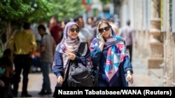 Iranian women walking in Ferdowsi street in Tehran, Iran, July 6, 2019.