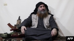 Abu Bakr al-Baghdadi as he appeared in a video released in April