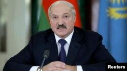 Президент Білорусі під час зустрічі у Москві, 23 грудня 2014 року