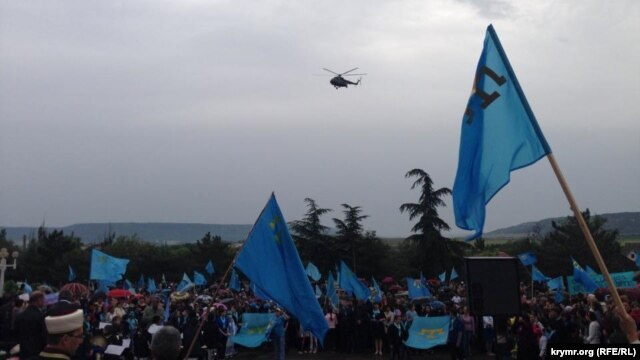 Helicopters circle overhead at a rally by Crimean Tatars in Bakhchyseray on May 18.