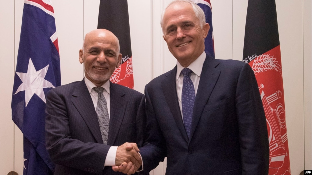 Australian Prime Minister Malcolm Turnbull (right) poses with the visiting Afghan President Ashraf Ghani in Canberra on April 3.