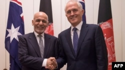 Australian Prime Minister Malcolm Turnbull (R) poses with the visiting A fghan President Ashraf Ghani in Canberra on April 3, 2017.