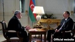 Prezident İlham Əliyev Mixail Qusmanla müsahibədə, 23 dekabr 2011