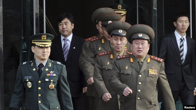 North Korean Colonel Ri Son-kwon (front right) led talks for the North in the village of Panmunjom.