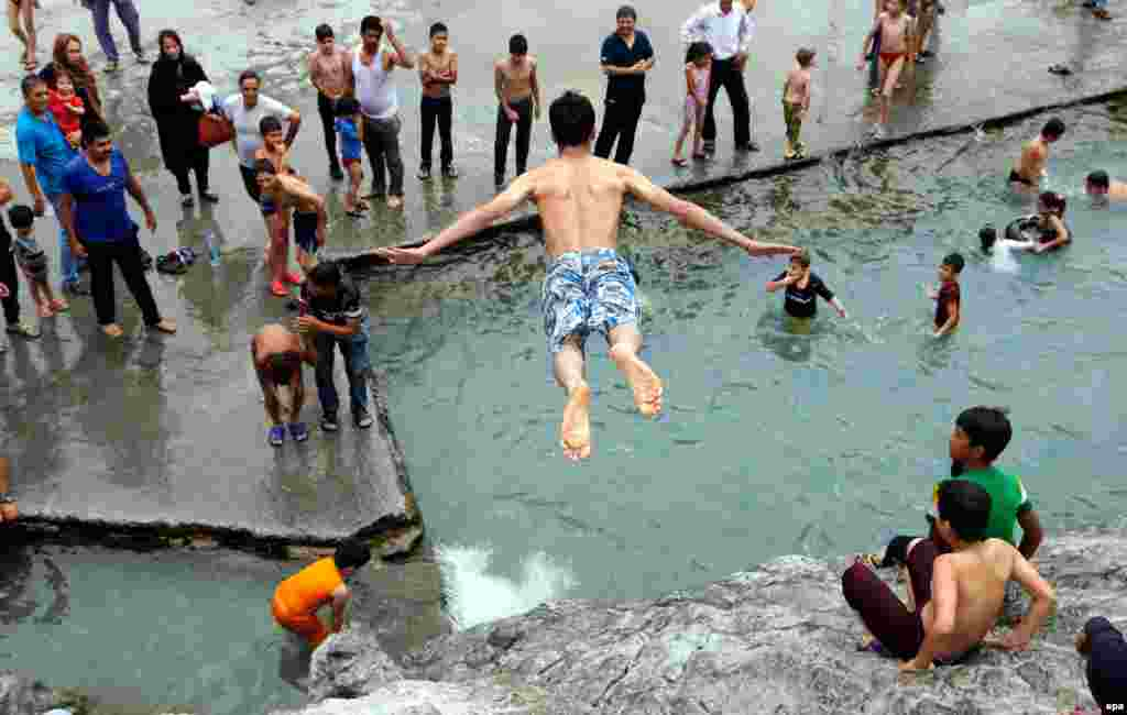 An boy jumps into the Cheshme-Ali pool located in the city of Shahre-Ray in central Iran, on July 22. (epa/Abedin Taherkenareh)