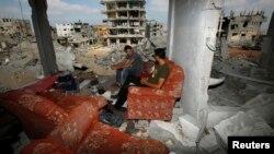 Свидетели в Газе утверждают, что этот дом подвергся обстрелу, август 2014 г.