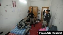 Police search Mashal Khan's dorm room on April 14, 2017.