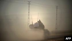 Tanket turke duke hyrë në Siri...