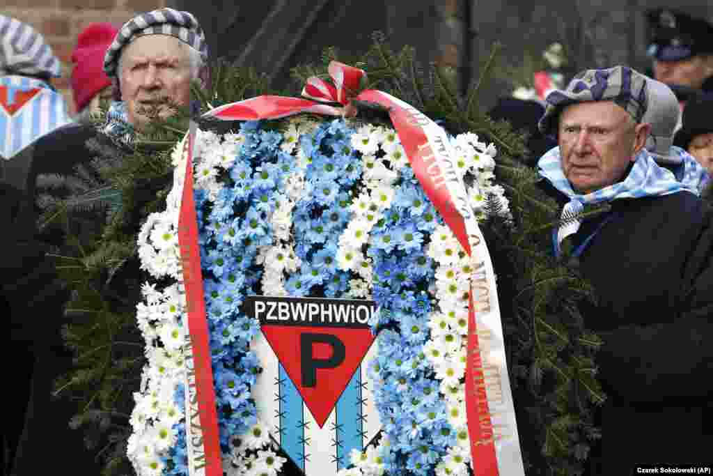 Survivors carry a wreath at the Auschwitz Nazi death camp in Oswiecim, Poland, January 27, 2020.