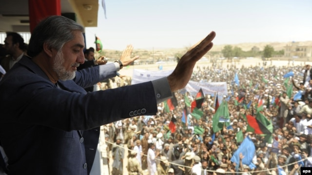 Afghan presidential candidate Abdullah Abdullah speaks to supporters during a campaign appearance in Baghdis, Afghanistan, on June 2.