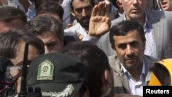 Iran -- President Mahmud Ahmadinejad (R) participates in the Jerusalem Day demonstration in Tehran, 26Aug2011