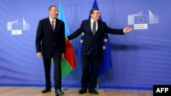 Azerbaijani President Ilham Aliyev (left) with European Union Commission President Jose Manuel Barroso prior to a meeting at the EU Commission headquarters in Brussels on June 21