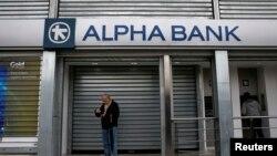 Tokom ekonomske krize u Grčkoj bilo je diskusija da li će se Rusija više uključiti u toj zemlji i naterati je da napusti EU: Dejevsky (na slici: zatvorene banke u Atini))