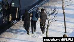 A protester is arrested in Minsk on January 23.