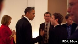 U.S. President Barack Obama gestures to Facebook founder and CEO Mark Zuckerberg at a California high-tech leaders dinner in February