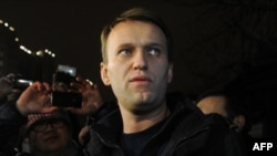 Anti-Kremlin blogger Aleksei Navalny speaks to journalists and supporters outside a police station in Moscow in December.