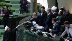 Iran's President Hassan Rouhani presenting his budget proposal in parliament, December 10, 2017