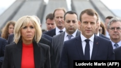 French President Emmanuel Macron (left), first lady Brigitte Macron, members of the French delegation, and Armenian officials visit the Tsitsernakaberd Armenian Genocide Memorial in Yerevan in October.