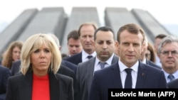 French President Emmanuel Macron and his wife, Brigitte Macron, during a visit at Yerevan's Tsitsernakaberd Armenian Genocide Memorial on October 11.