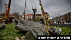 The monument to Marshal Konev lies on the ground after being removing from its pedestal in Prague on April 3.