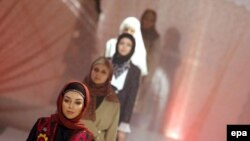 Iranian models walk the catwalk during a fashion show in Tehran in early 2007.