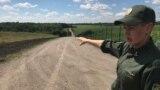 Ukrainian border guard Oksana Ivanets near the frontier fence with Russia in eastern Ukraine
