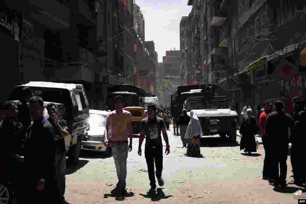 Egyptian security vehicles remain stationed in a poor area of the Qaliubia governorate, north of Cairo, following sectarian clashes between Christians and Muslims on April 6, which left five people dead. (AFP)