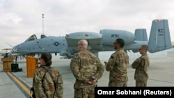 FILE: U.S air force personnel stand by an U.S. A-10 aircraft at the Kandahar airbase in January 2018.