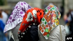 The ruling is the first on the issue of women wearing head scarves at work in the European Union.