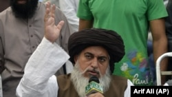 FILE: Khadim Hussain Rizvi, head of the Tehrik-e Labaik Pakistan, a hard-line religious political party, speaks to supporters in November 2018.