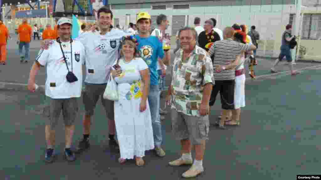 "Toldina and Oleg pose with visiting German fans Thomas from Munich (left) and Volker from Berlin (second from left) who came for the Netherlands vs. Germany match on June 13. ""It was a pity that they had to go back home,"" Toldina said."