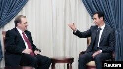 Presidenti srian Bashar al-Assad dhe zëvendësministri i jashtëm rus, Mikhail Bogdanov