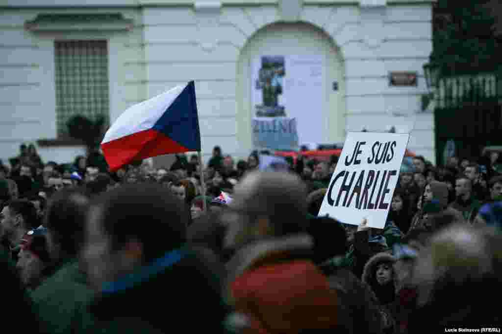 Czech Republic -- Anti-Islam demonstrators hold banners and Czech flags during a protest in Prague on January 16, 2015