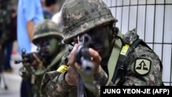 South Korean soldiers take up positions during an antiterror drill on the sidelines of a South Korea-U.S. joint military exercise called Ulchi Freedom Guardian, at a subway station in Seoul on August 19.