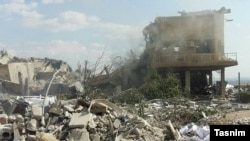 The rubble of buildings in Syria after being hit by air strikes launched by the United States, Britain, and France.