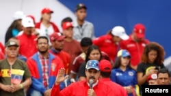 Venezuela's President Nicolas Maduro attends a rally in support of the government and to commemorate the 20th anniversary of the arrival to the presidency of the late President Hugo Chavez in Caracas, Venezuela February 2, 2019. REUTERS/Manaure Quintero