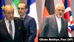 From left, French Foreign Minister Jean-Yves Le Drian, German Foreign Minister Heiko Maas and Iranian Foreign Minister Javad Zarif. Fle photo