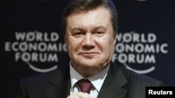 Ukrainian President Viktor Yanukovych attends a session at the World Economic Forum in Davos last year. A new report highlights his administration's lack of progress in implementing economic reform.