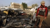 آثار إنفجار قنبلة في مدينة الشعلة ببغداد