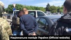 Задержание вербовщиков украинцев для перевозки нелегалов, фото Нацполиции Украины