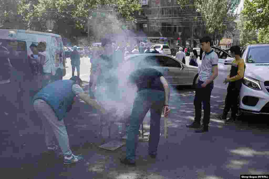 Protesters hold a barbecue on Yerevan's Shashlik Street. The general strike often took on a festive atmosphere.