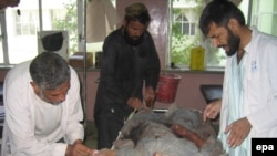 A civilian injured in U.S.-led coalition air strike receives treatment in Kandahar